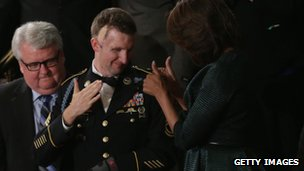 First lady Michelle Obama (R) stands with US Army Ranger Sergeant First Class Cory Remsburg
