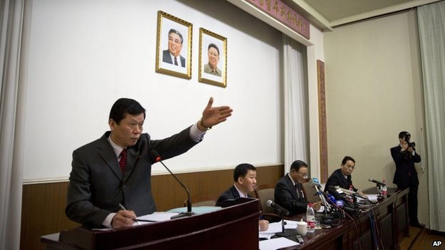 A North Korean embassy official gestures to allow questions at a press conference by North Korean Ambassador to China Ji Jae Ryong, seated centre, at the North Korean Embassy in Beijing, China, 29 January 2014
