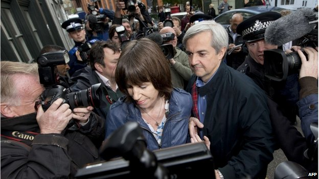 Chris Huhne and partner Carina Trimingham surrounded by photographers on his release from prison