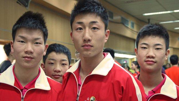 Lu Yihai (centre), 19, Wushu performer from Shandong province