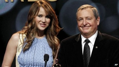 Tom Sherak with Jennifer Lawrence at the Oscar nominations while president of the Academy in 2012