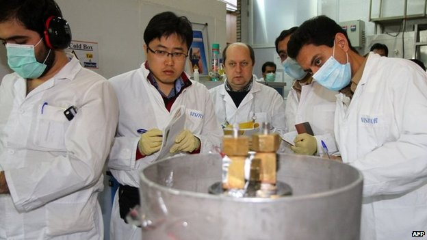 International Atomic Energy Agency (IAEA) inspectors and Iranian technicians at nuclear power plant in Natanz
