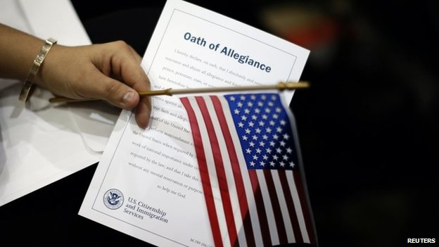 A woman holds the Oath of Allegiance at a naturalisation ceremony in Los Angeles