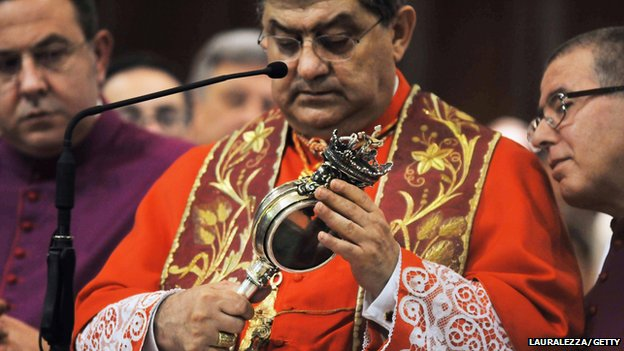 Picture of the Cardinal of Naples holding the phial containing the blood of 5th-Century martyr Saint Januarius
