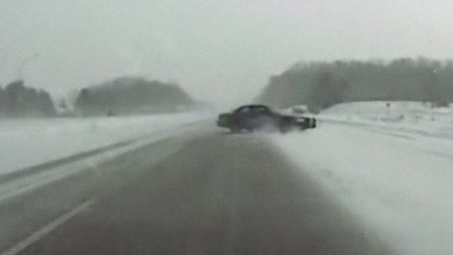 Car spins in road in US