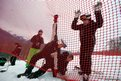Olympic workers mount a suppressor grid on the mountainside in Sochi, Russia
