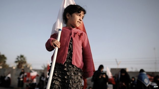 A young girl holds a Bahraini flag at an anti-government protest in Diraz, west of Manama (17 January 2014)
