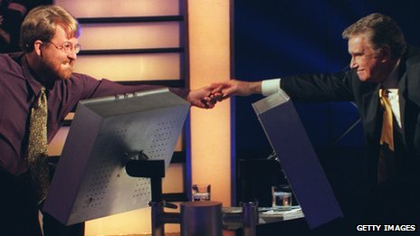 US Millionaire host Regis Philbin (r) and contestant