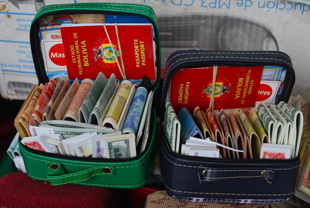 Miniature suitcases containing money