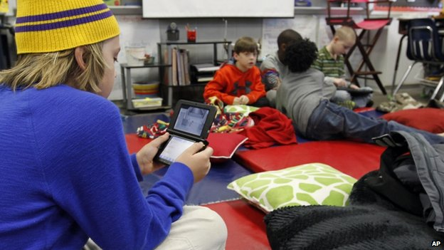 A student played an electronic game at Oak Mountain Intermediate school in Indian Springs, Alabama, on 29 January 2014