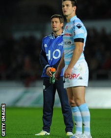 Jonny Sexton lines up a kick while Ronan O'Gara watches on