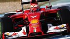 Finland's Kimi Raikkonen gets to grips with his new Ferrari during day two at Jerez