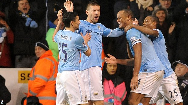 Manchester City celebrate at White Hart Lane