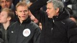 Chelsea's Portuguese manager Jose Mourinho argues with the fourth Official Michael Jones (left)