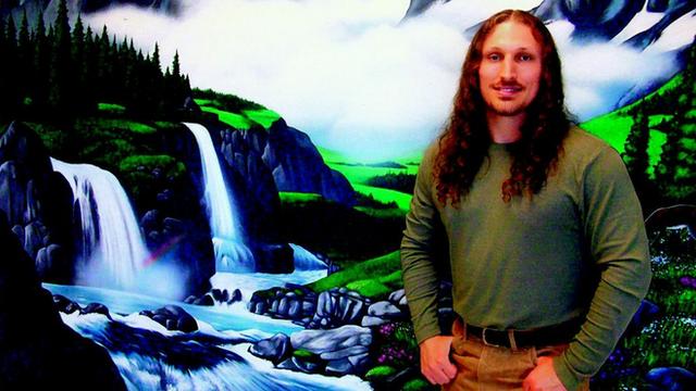 Prisoner in front of backdrop
