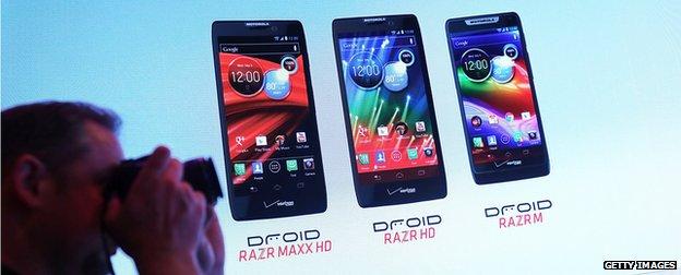 Photographer clicking a photo of Motorola phones