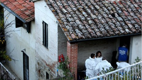 Police search the house where the murder occurred in Perugia, Italy, 3 November 2011