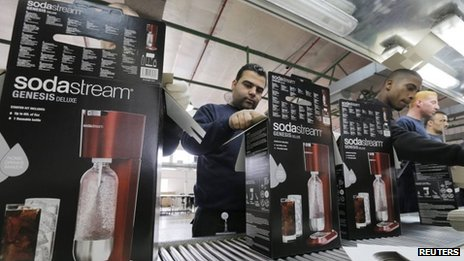 Employees pack boxes of the SodaStream product at the factory in the West Bank Jewish settlement of Maale Adumim on 28 January 2014