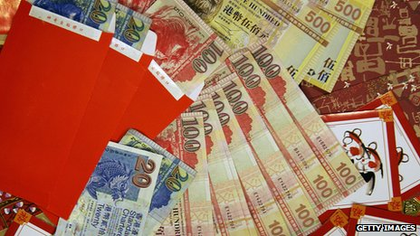 Red envelopes filled with Hong Kong dollars