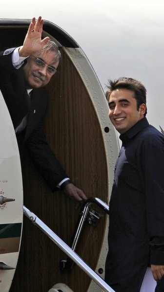 The Pakistani President Asif Ali Zardari, left, waves as his son Bilawal Bhutto Zardari looks on, at an airfield in New Delhi, India, in April 2012