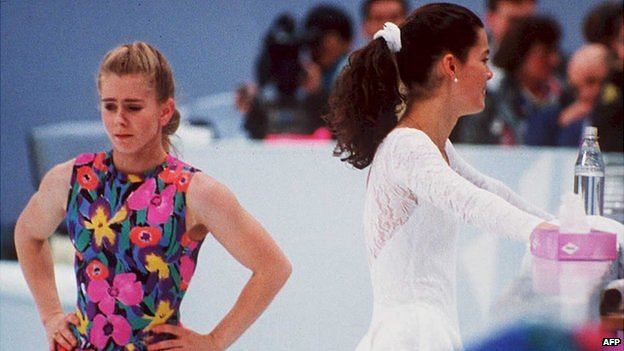 Tonya Harding (left) walks past Nancy Kerrigan (right) during a practice session in Hamar, Norway