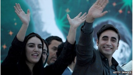 The chairman of the Pakistan Peoples Party, Bilawal Bhutto Zardari (right) and his sister Bakhtawar wave to supporters at a rally in Karachi on 30 November 2013