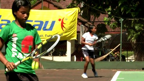 Young Indonesian tennis playing twins Fitriani Sabatini (green, left) and Fitriana Sabrina Mastuti