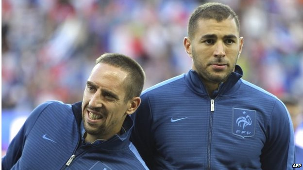 France's national football team forwards Franck Ribery, left, and Karim Benzema, right, before the start of the 2014 World Cup qualifying play-off second-leg football match between France and Ukraine at the Stade de France, outside Paris