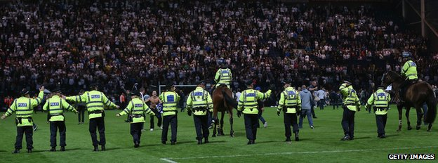 Police on football pitch