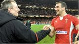 Wales coach Robert Howley shakes captain Sam Warburton's hand following victory against England in 2013.