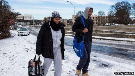 Two high school students walk along a frozen Atlanta highway on January 29, 2014.