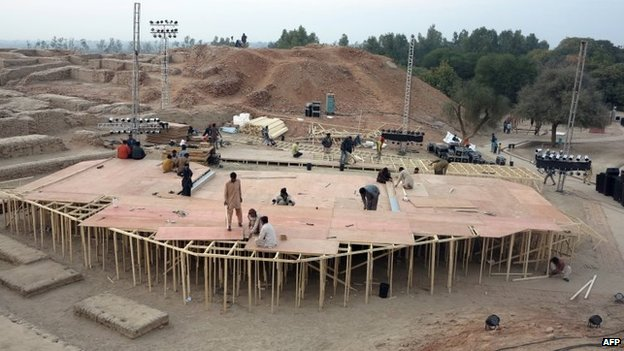 Pakistani workers prepare a stage around the ancient ruins, ahead of the Sindh Festival opening ceremony in Mohenjo Daro