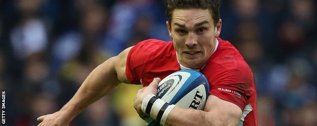Wales wing George North runs with the ball