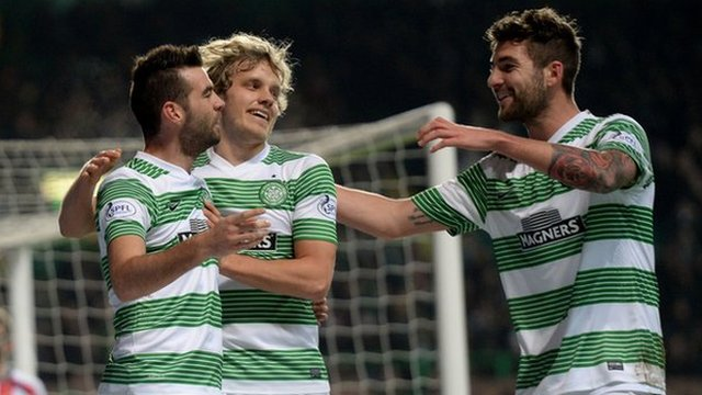 Joe Ledley celebrates with Teemu Pukki and Charlie Mulgrew after opening the scoring.