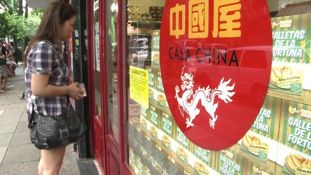Woman outside 'Casa China' shop