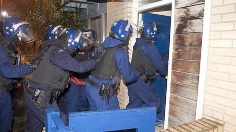 Police raid address in Stockwell, south London, on 30 January 2014