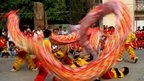 Chinese Cambodian men perform a dragon dance to celebrate the upcoming Chinese new year at the Chinese Embassy in Phnom Penh in Cambodia