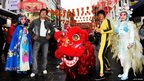 Braving Britain's rain, wax figures of Bruce Lee and Jackie Chan pay a visit to London's Chinatown