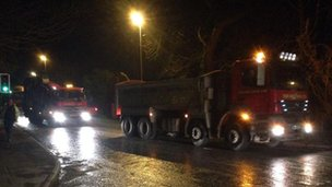 Lorries deliver sand to Somerset