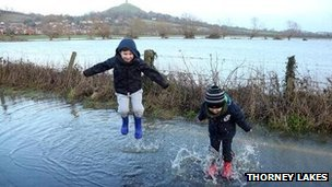 Children splashing in flood water