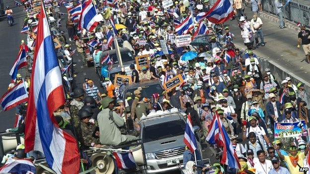 Thai anti-government protesters wave national flags during a rally in Bangkok on 31 January 2014