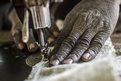 Amagali Guindo using a sewing machine in a Dogon village in Mali