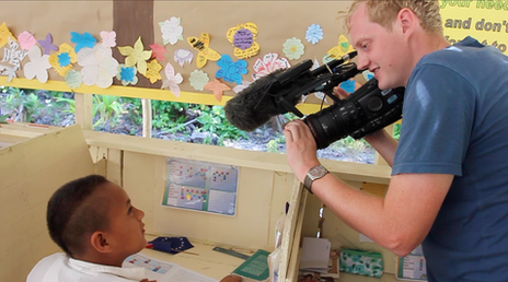 Thomas Martienssen filming a child in the local school