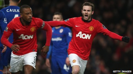 New signing Juan Mata of Manchester United celebrates Robin van Persie scoring against Cardiff