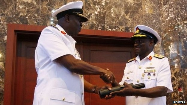 New Chief of Naval Staff, Rear Admiral Usman O. Jibrin (L), receives a periscope from the outgoing Vice Admiral Dele Joseph Ezeoba during a handing over ceremony at the Defence Ministry headquarters in Abuja January 20, 2014.