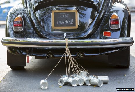 "Car with ""Just married"" and tin cans on bumper"