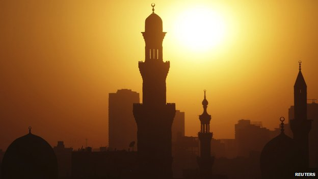 The sun sets over the minarets of mosques on the 12th day of the holy fasting month of Ramadan, in Old Cairo (July 21, 2013)
