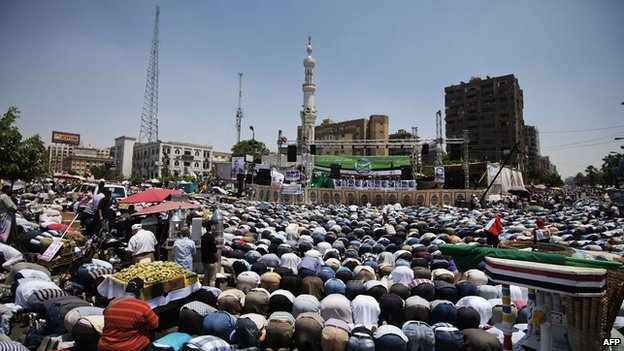 Thousands of Islamists and Muslim Brotherhood supporters perform the Friday prayers as they gather at Rabaa al-Adawiya mosque to start an open-ended sit-in in support of the legitimacy of President Mohamed Morsi in Cairo (June 28, 2013)