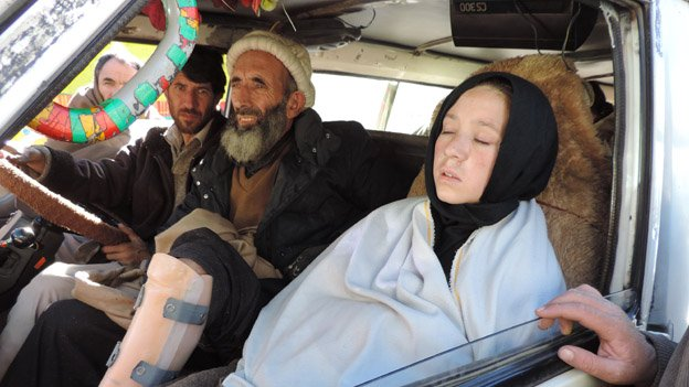 Young girl and recuperating man stuck at Lowari
