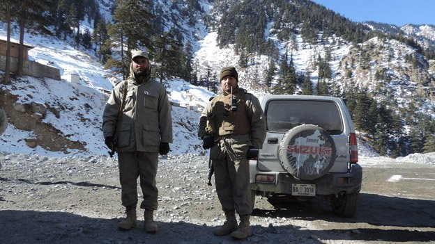 Two Chitral Scouts soldiers on duty along the approach to the Chitral end of the tunnel